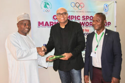 Receiving gift from IOC VP