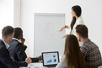 businesswoman-giving-presentation-of-marketing-research-results-at-business-training.jpg