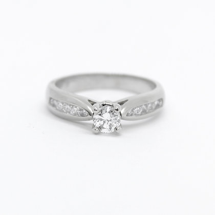 Round Solitaire Diamond Engagement Ring With Tapered Diamond Band