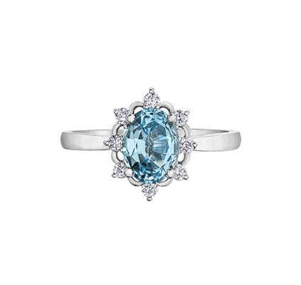 Oval Aquamarine Ring With Decorative Diamond Halo