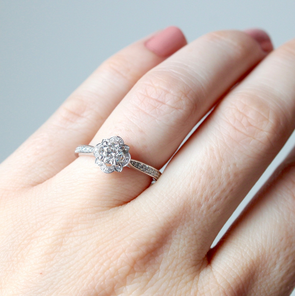 round diamond engagement ring with fancy diamond halo and diamonds on band, set in white gold