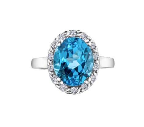 Oval Cut Blue Topaz Ring With Diamond Halo