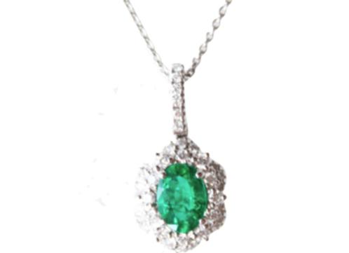 Oval Cut Emerald Pendant With Diamond Halo