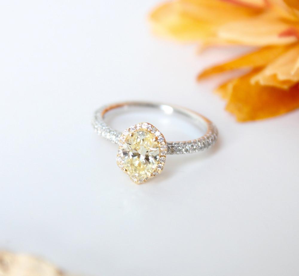 oval cut yellow diamond engagement ring with diamond halo