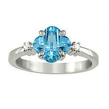 Van Cleef Shaped Blue Topaz Ring