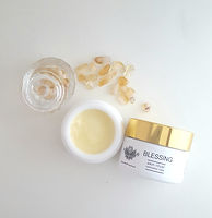 Blessing Restorative Salve in a white opal jar with gold lid and natural Citrine crystals