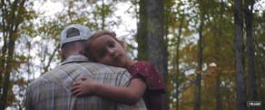 Bryant carrying daughter.jpg