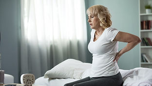 Blond mature lady sitting on bed and tou