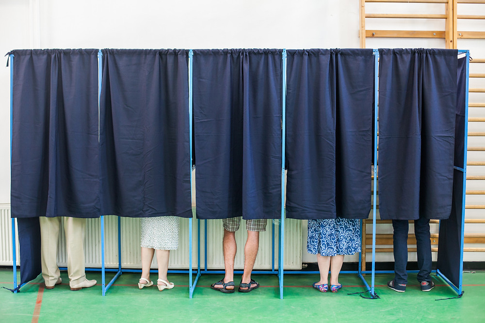 closed curtains on voting booths