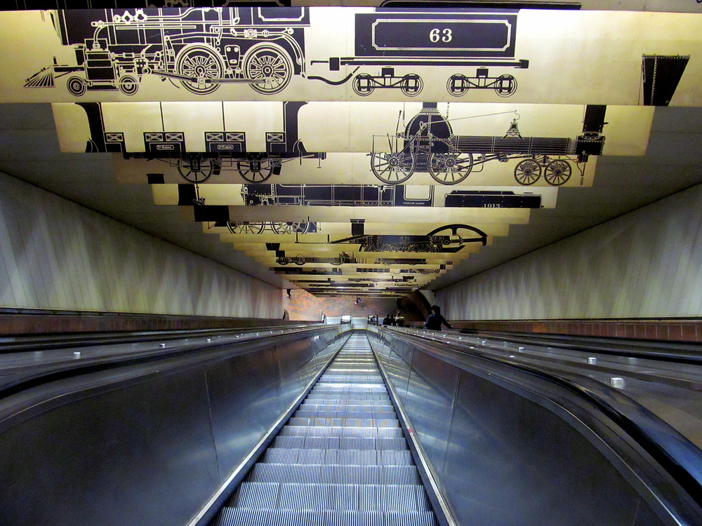 Escalator going down to Porter Square T