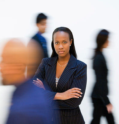 Image of young African American woman in midst of blurred figures passing her by, symbolizing going through interpersonal adjustment
