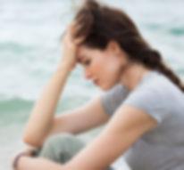 Image of young woman symbolizing feeling sad, scared, and traumatized