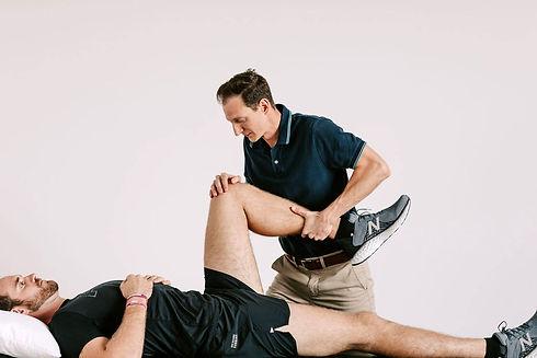 Brent moving patient's leg