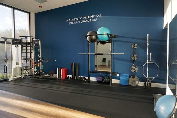 Yoder gym setup with squat rack.jpeg