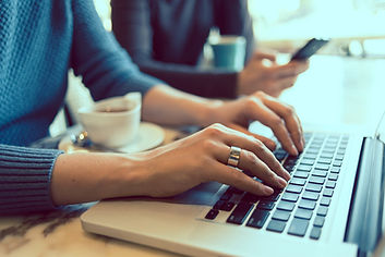 Woman's hands typin on laptop coputer