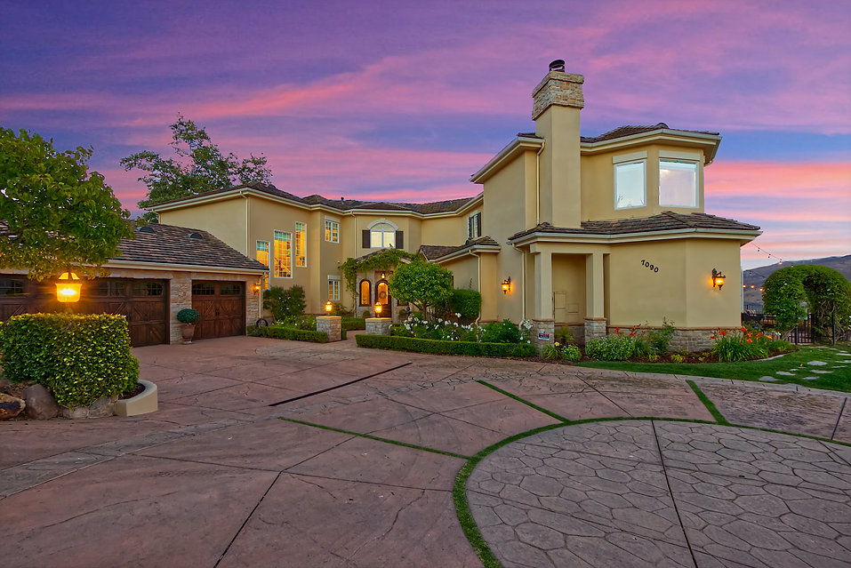 7090 Los Coyotes Pl sunset front of home.jpg