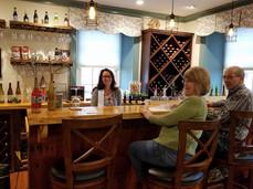 Rebecca Behind the Wine Bar