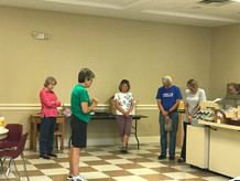 Nancy Williams leads First Baptist Church of Boone volunteers in prayer during High Country Impact