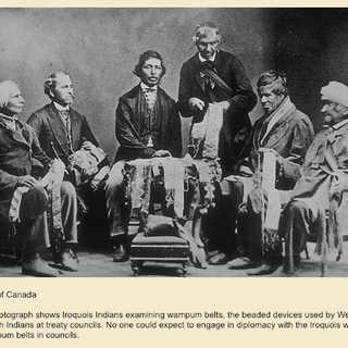 Chiefs from the Six Nations Reserve at Brantford, Ontario, reading Wampum belts, circa 1870s.