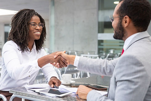smiling-businesswoman-shaking-hands-with