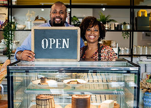 cake-cafe-owners-with-open-sign.jpg