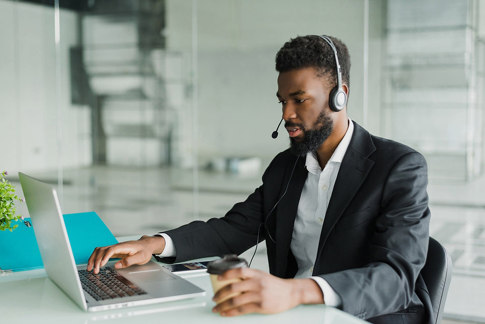african-american-man-headset-working-off
