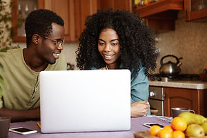 happy-young-afro-american-family-sitting