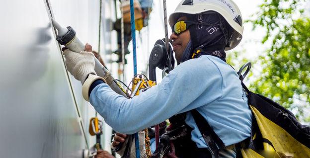 Hydro-Seal Rope Access Technician Applying Sealant to External Facade