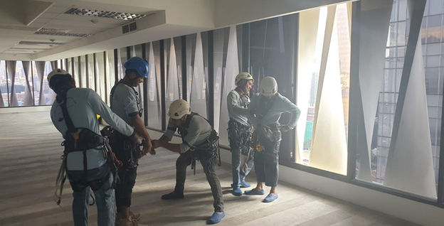 Rope Access Team Performing Harness & Safety Check