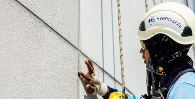 Rope Access Technician performing inspection to external facade