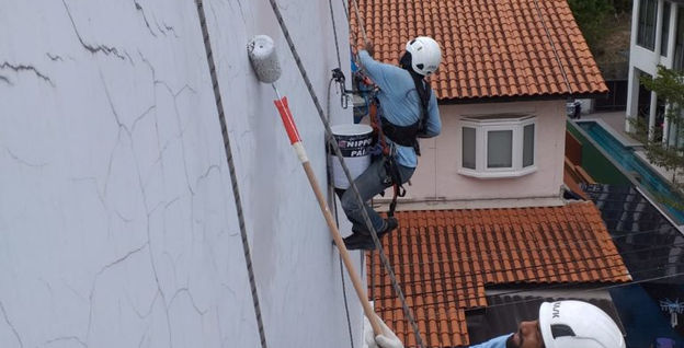 Hydro-seal Engineering Rope Access Technician Performing External Residential Building Painting Works