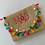 Thumbnail: Colorful Tassle Clutch