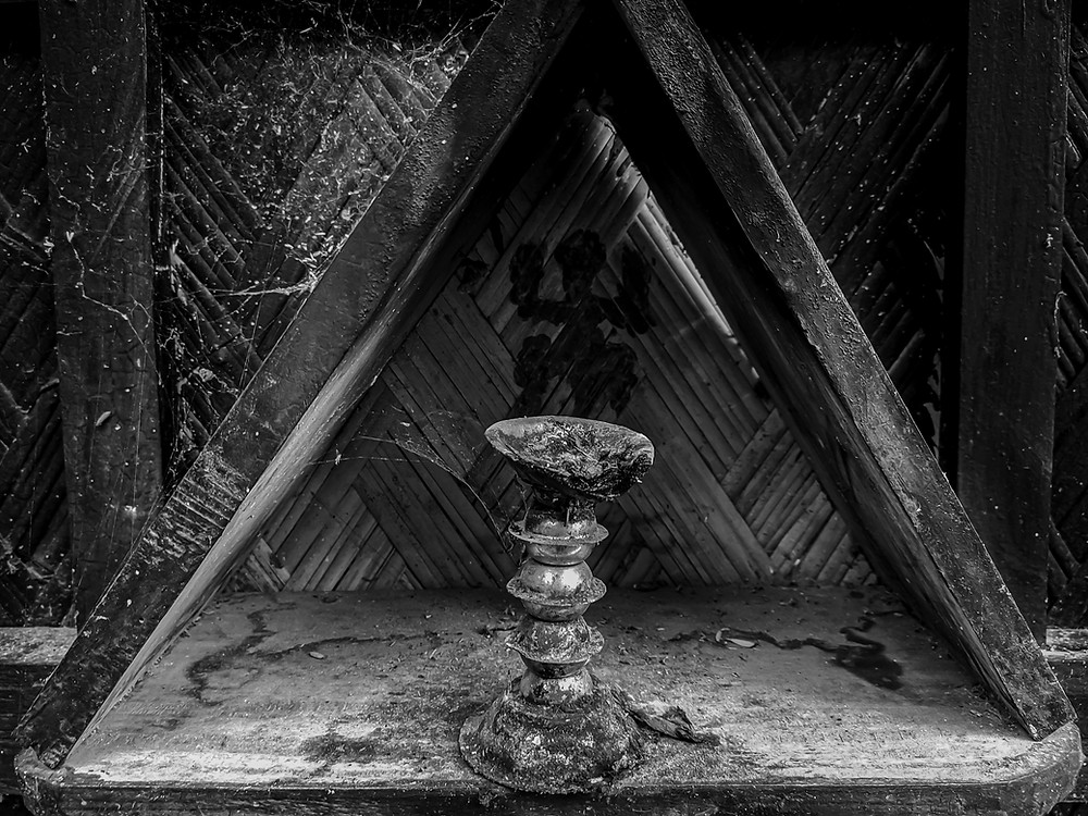 Black and white photo of a burnt candlestick