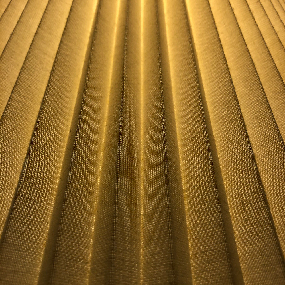 Close up of tan yellow pleated fabric