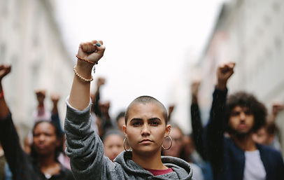 Young woman protesting on the street wit