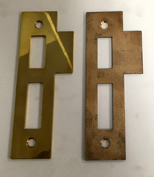 Reproduction of an antique entry door strike plate. 5 x 2 7/8