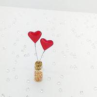 Two pink love hearts, mini bottle