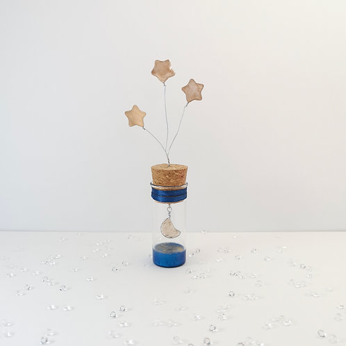 Three stars and the moon, glass bottle