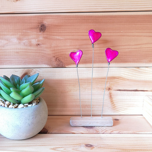 Wire and driftwood sculpture, 3 pink love hearts