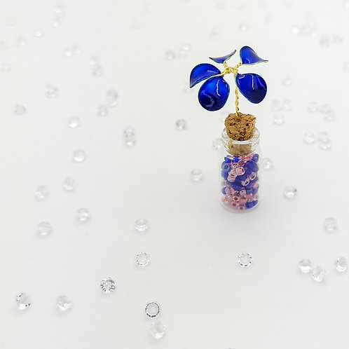 Blue flower and seed beads, mini bottle