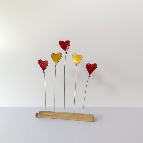 Wire and driftwood sculpture, 3 red and 2 gold love hearts