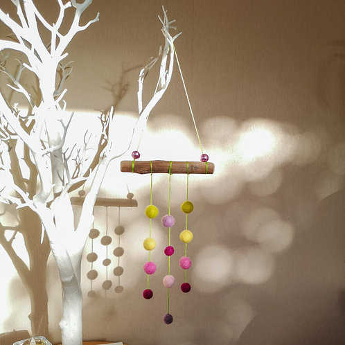 Felt ball wall hanging on driftwood - Pink and green