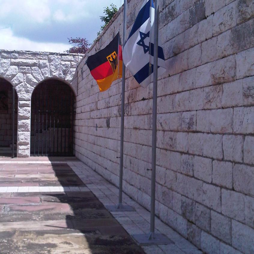 Flags of Germany and Israel at  half-mas