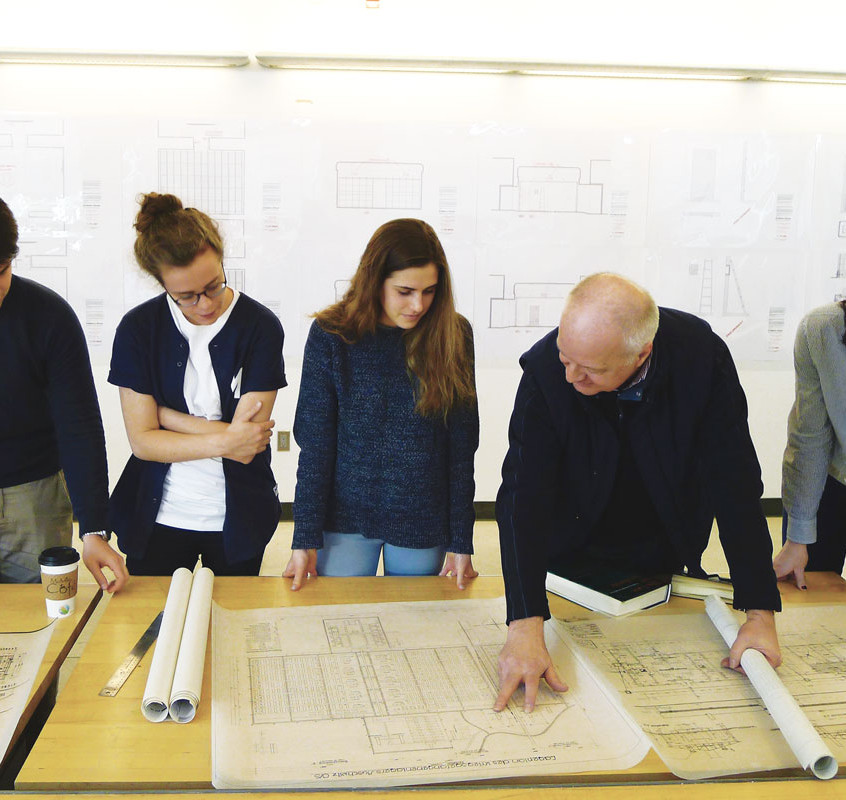 Prof. Robert Jan van Pelt reviewing  blueprints for The Evidence Room