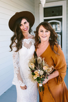 Rachel with her soft waves and her bridesmaid with half up half down.