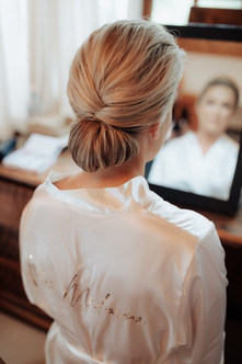 This elegant chignon with smooth texture was so perfect for Jo on her wedding day