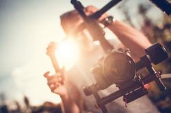 Camera Gimbal DSLR Video Production.jpg Pro Video Stabilization.jpg Video Maker Taking Shoots Using