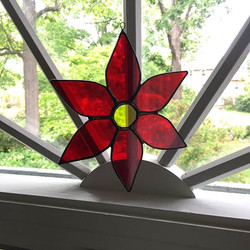A Glasstastic Studio creation in its new home! This poinsettia just pops in this window! #glasstasti
