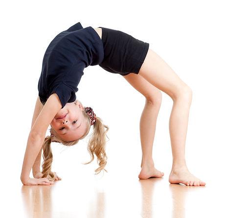 young girl doing gymnastics over white b