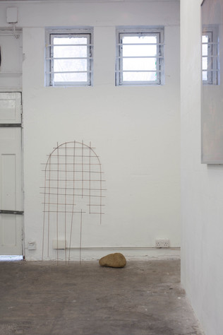 Arch with fallen head and gold intervention - installation view